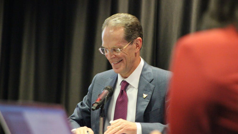 In this Jan. 31, 2020, photo, President Geoffrey Mearns signs the documentation to extend his presidency at Ball State's Board of Trustees meeting. Ball State will begin to reopen campus and campus activities in three phases. Bailey Cline, DN