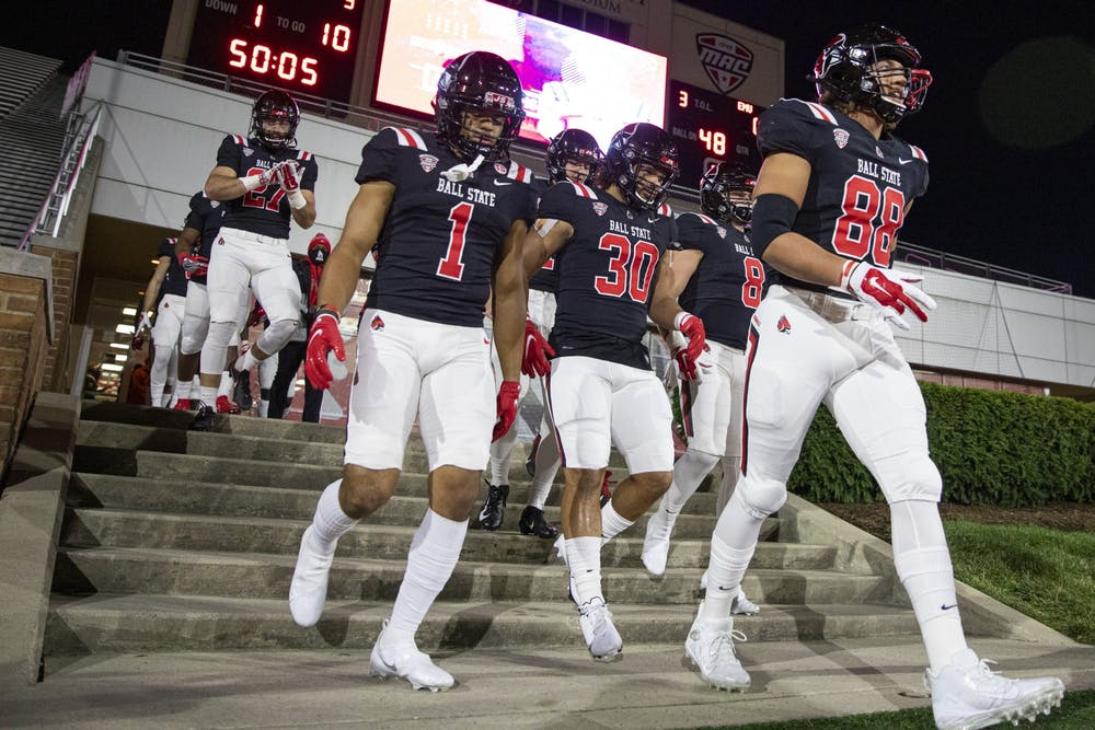 <p>The offense walks out of the locker room before walking out to take on the Eastern Michigan Eagles Nov. 11, 2020, at Scheumann Stadium. The Cardinals beat the Eagles 38-31. <strong>Jacob Musselman, DN</strong></p>