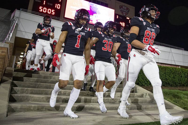 The offense walks out of the locker room before walking out to take on the Eastern Michigan Eagles Nov. 11, 2020, at Scheumann Stadium. The Cardinals beat the Eagles 38-31. Jacob Musselman, DN