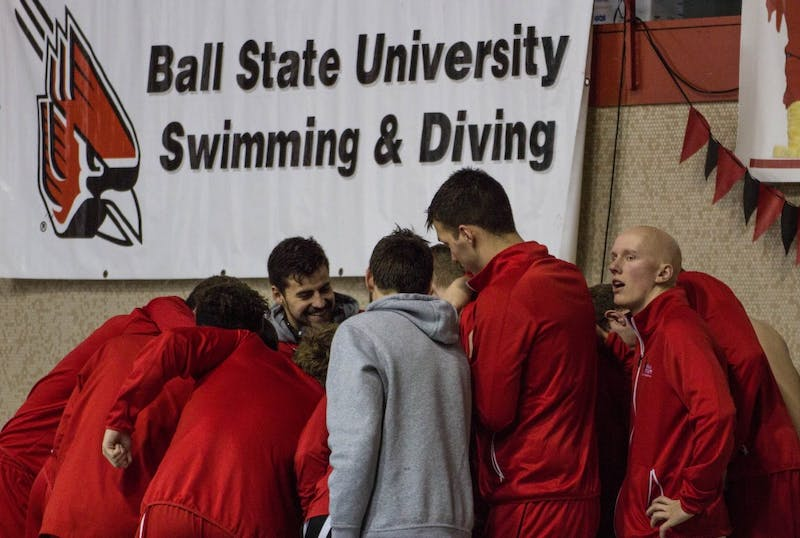 The Ball State men's swimming and diving team huddle before the senior meet against Notre Dame on Feb. 4 in Lewellen Pool. The Cardinals lost 82.5-148.5. Grace Ramey // DN