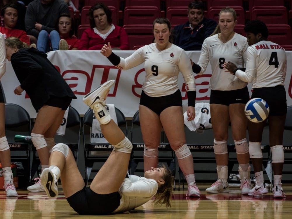 After a misplaced return, Ball State Women's Volleyball scrambled to keep the ball in play Oct. 12, 2018, in John E. Worthen Arena. The Cardinals are now 19-7 on the season and 10-3 in conference play. Eric Pritchett,DN