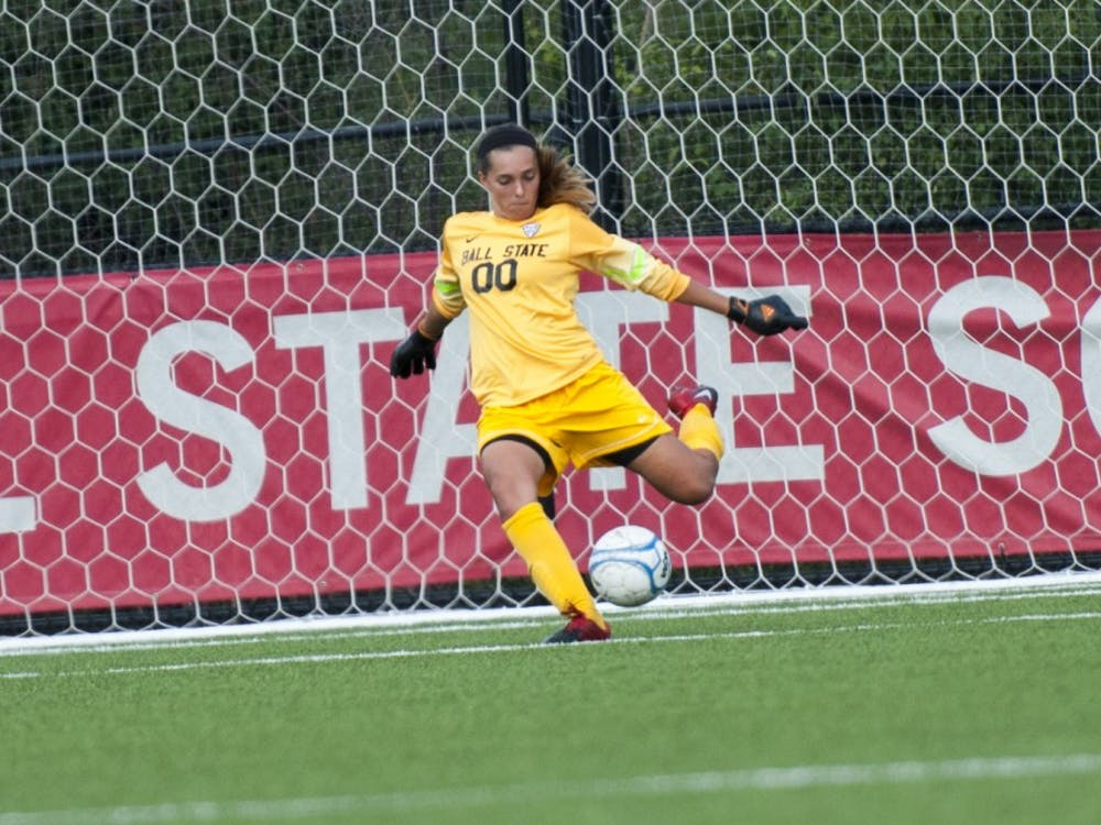 Sophomore goal keeper Brooke Dennis clears the net during Ball State