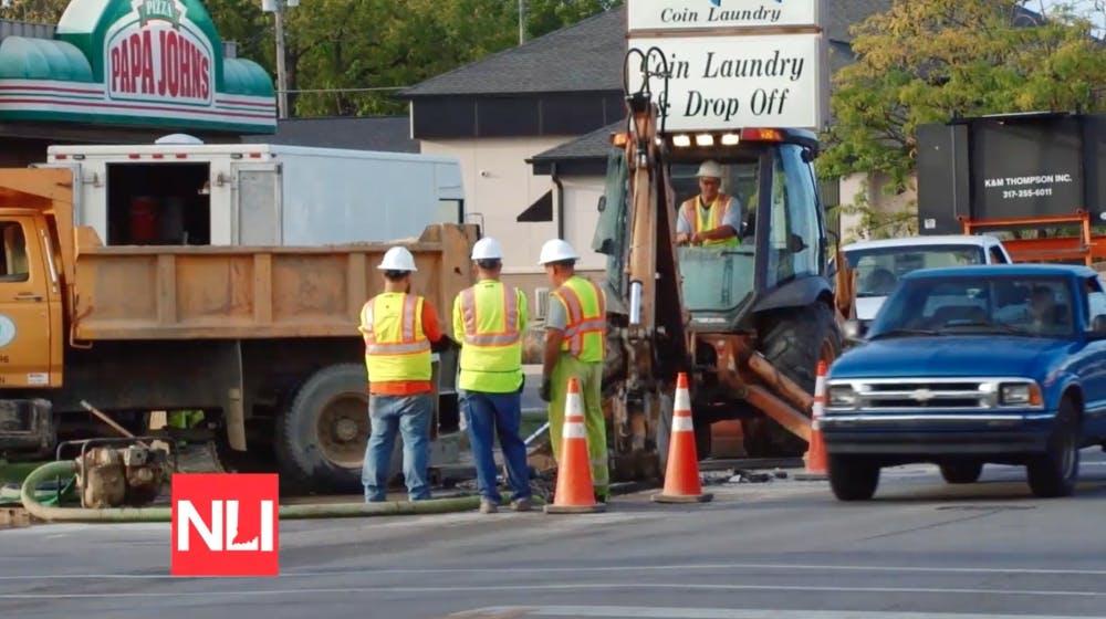 <p>Crews work to fix one of three water main breaks on Madison Street in Muncie on Tuesday.</p> <p>Tony Sandleben</p> <p>NewsLink Indiana</p>