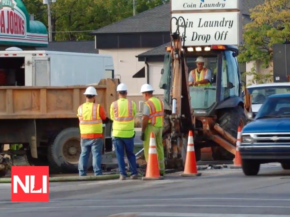 Crews work to fix one of three water main breaks on Madison Street in Muncie on Tuesday. Tony Sandleben NewsLink Indiana