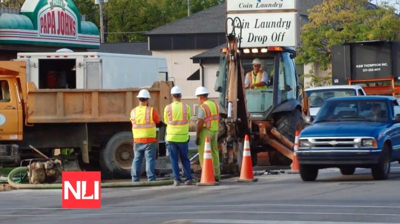 Crews work to fix one of three water main breaks on Madison Street in Muncie on Tuesday. Tony Sandleben NewsLink Indiana