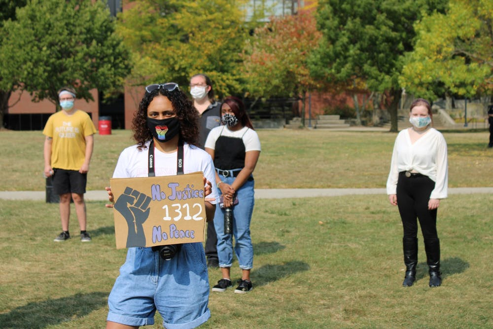 <p>Students stand socially distant on University Green at the &quot;Emphasizing Equity&quot; event Sept. 26, 2020. Approximately 40 students, activists and organizers gathered to discuss solutions to racial injustice. <strong>Angelica Gonzalez Morales, DN</strong></p>