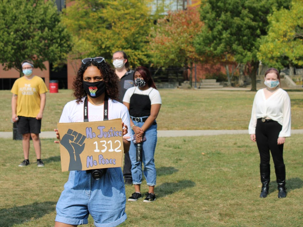 "Students stand socially distant on University Green at the ""Emphasizing Equity"" event Sept. 26, 2020. Approximately 40 students, activists and organizers gathered to discuss solutions to racial injustice. Angelica Gonzalez Morales, DN"