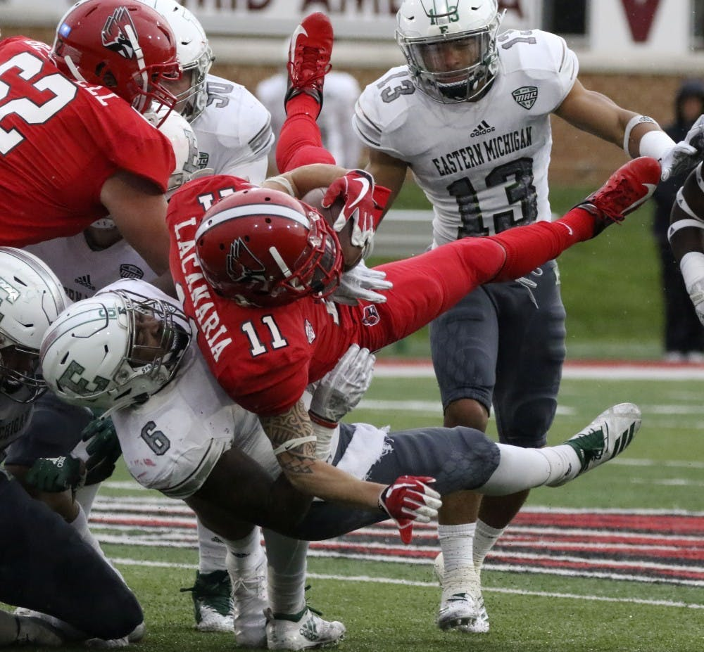 <p>Ball State redshirt senior wide receiver Corey Lacanaria gets tackled by Eastern Michigan University's Jaylen Pickett during the Cardinals' game against the Eagles Oct. 20, 2018 at Scheumann Stadium. Pickett had two solo tackles. <strong>Paige Grider, DN</strong></p>