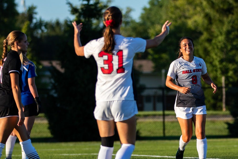 Tatiana Mason calls over Paula Guerrero to celebrate after Guerrero scores a goal securing Ball State's win against the University of Nebraska-Omaha Friday, Sept. 14, 2018 at Briner Sports Complex. All points were scored in the second half of the game where Ball State won 3 to 1. Eric Pritchett,DN