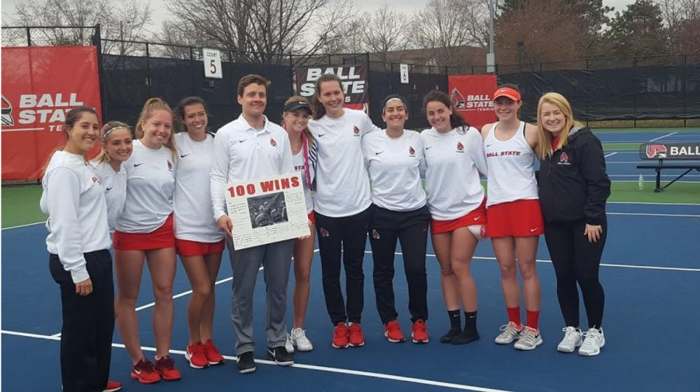 <p>The Ball State Women's Tennis team poses with head coach Max Norris after he picks up his 100th win against Buffalo on April 5, 2019 at Cardinal Creek. Ball State swept the Bulls 7-0.<strong> Evan Weaver, DN</strong></p>