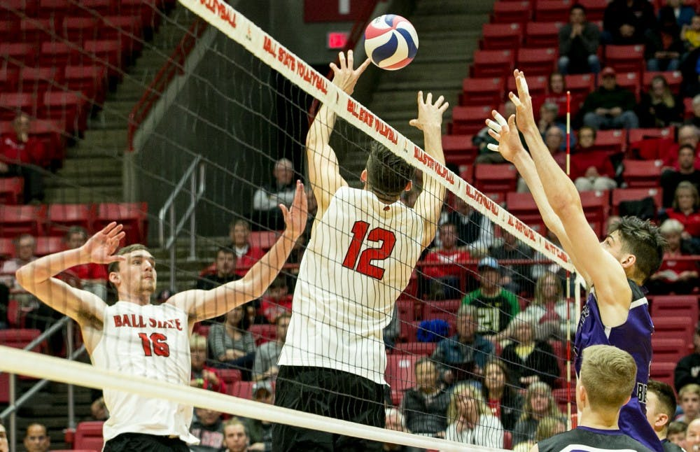 <p>Sophomore setter Jake Romano sets the ball to senior outside attacker Matt Walsh during the MIVA Tournament Quarterfinals against McKendree April 14 in John E. Worthen Arena. Romano had 36 assists throughout the sets. <strong>Kaiti Sullivan, DN</strong></p>