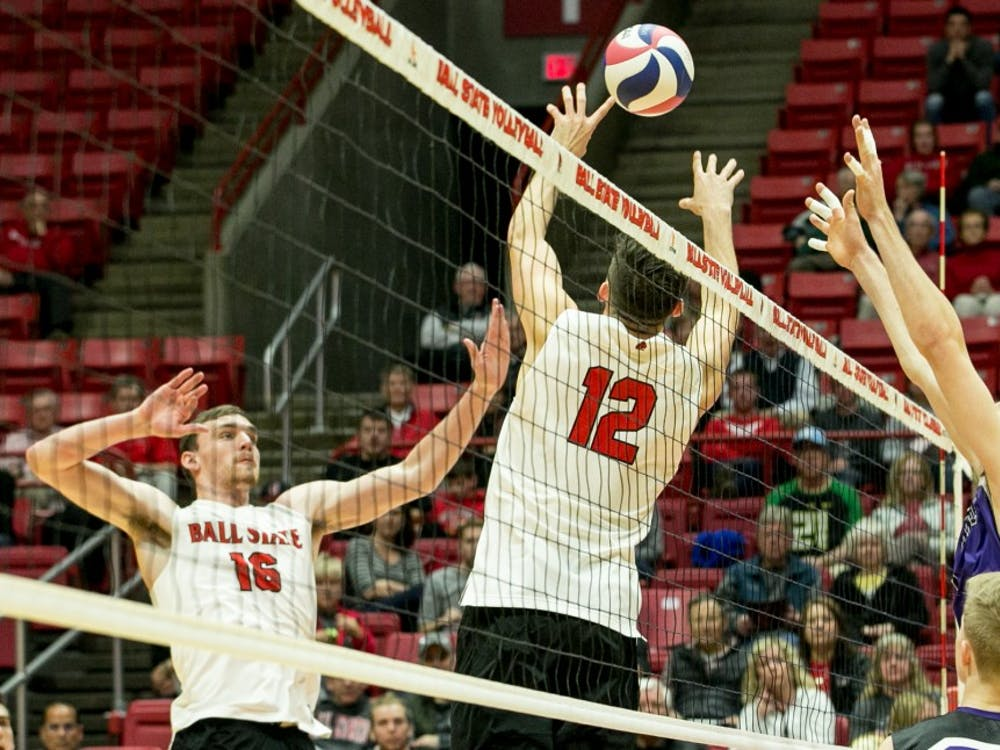 Sophomore setter Jake Romano sets the ball to senior outside attacker Matt Walsh during the MIVA Tournament Quarterfinals against McKendree April 14 in John E. Worthen Arena. Romano had 36 assists throughout the sets. Kaiti Sullivan, DN