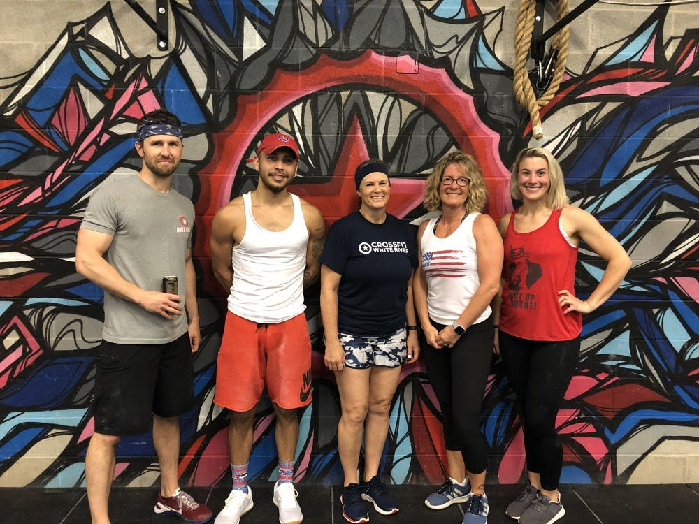 <p>(Left to right) Michael Harless, Shannon Fouce, Joy Wegener, Tisha Stone, Melissa Bjerke and (not pictured Zeke Bautista) are part of Crossfit White River's coaching staff. A sense of community is one of the reasons people like coming to the Crossfit in the Village. <strong>Tisha Stone, Photo Provided</strong></p>