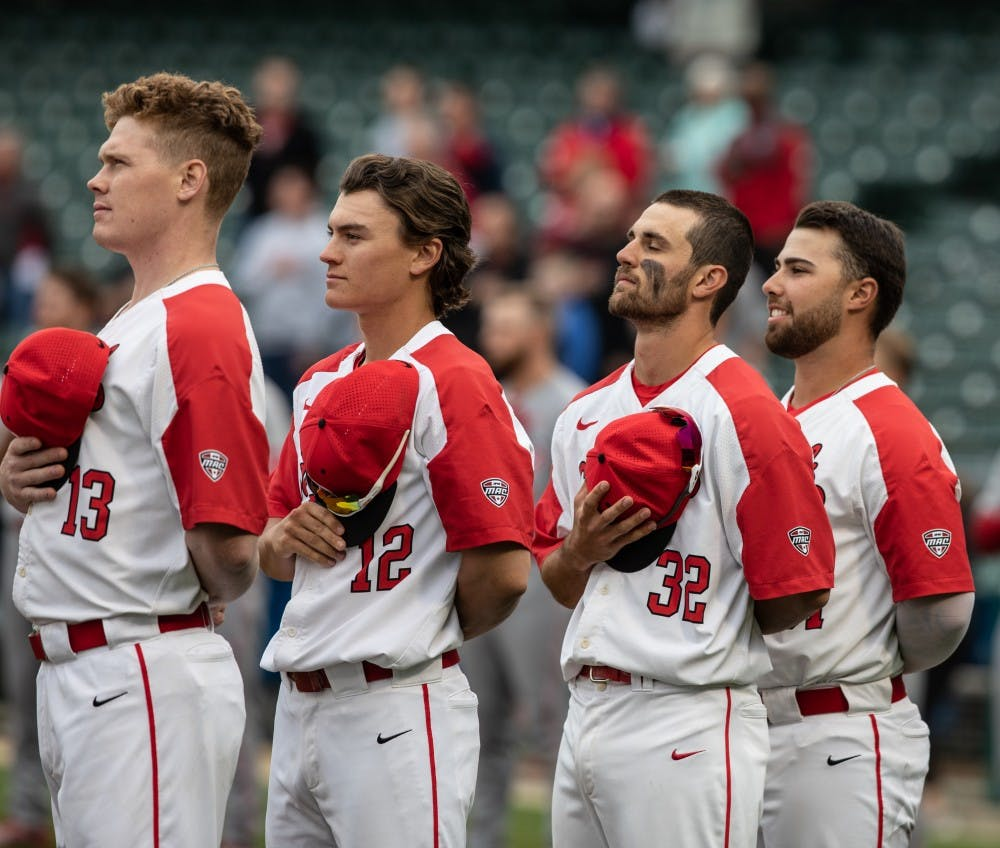 <p>Ball State Cardinals take off their hats as the National Anthem plays at Victory Field April 23, 2019. The Cardinals lost to the Hoosiers. <strong>Rebecca Slezak,DN</strong></p>