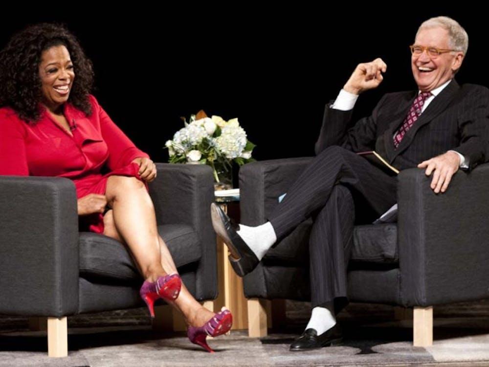 Oprah Winfrey and David Letterman laugh during their talk. DN PHOTO BOBBY ELLIS