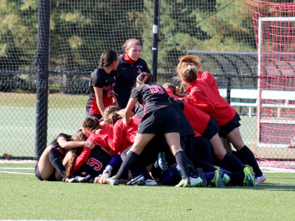 The Ball State Women's Soccer Team tackles and piles on their teammate after the winning goal in the match against Buffalo on Oct. 25 at the Briner Sports Complex. DN PHOTO ALLYE CLAYTON