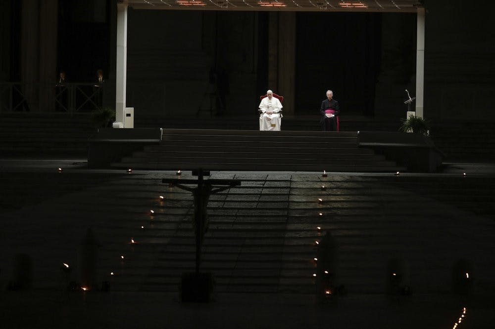 <p>Pope Francis is flanked by Mons. Guido Marini, right, the Vatican master of liturgical ceremonies, as he leads the Via Crucis – or Way of the Cross – ceremony in St. Peter's Square empty of the faithful following Italy's ban on gatherings to contain coronavirus contagion, at the Vatican, Friday, April 10, 2020. <strong>(AP Photo/Alessandra Tarantino)</strong></p>