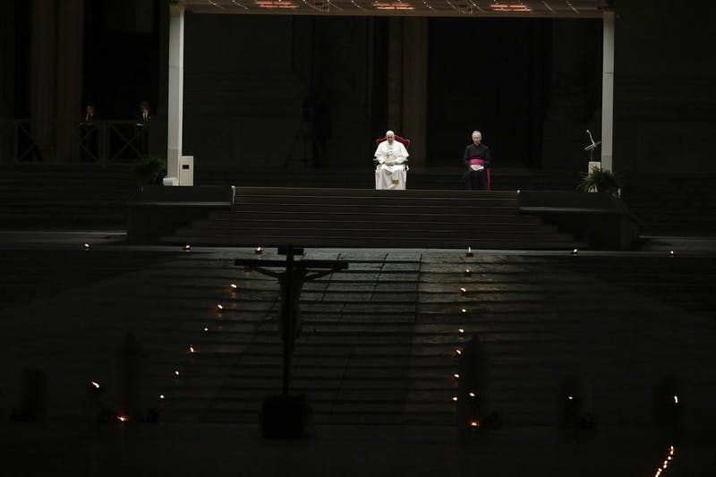 Pope Francis is flanked by Mons. Guido Marini, right, the Vatican master of liturgical ceremonies, as he leads the Via Crucis – or Way of the Cross – ceremony in St. Peter's Square empty of the faithful following Italy's ban on gatherings to contain coronavirus contagion, at the Vatican, Friday, April 10, 2020. (AP Photo/Alessandra Tarantino)