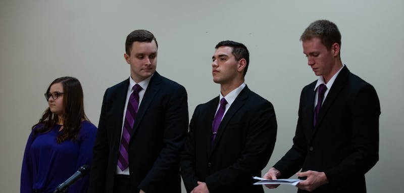 (Left to Right) Elevate's Cassidy Mattingly, secretarial candidate, Cameron DeBlasio, vice presidential candidate, Aiden Medellin, presidential candidate, and David Sinclair, treasurer candidate stand before the All-Slate Debate Feb. 18, 2019 in the L.A. Pittenger Student Center ballroom. Scott Fleener, DN