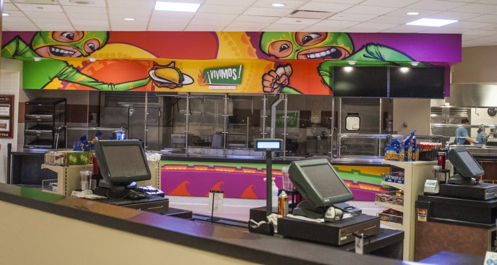 Vivimos sports a new paint scheme courtesy of the FAB crew on Oct. 28. The walls have since been repainted to the taupe color of the rest of the Atrium vendors. DN PHOTO JONATHAN MIKSANEK