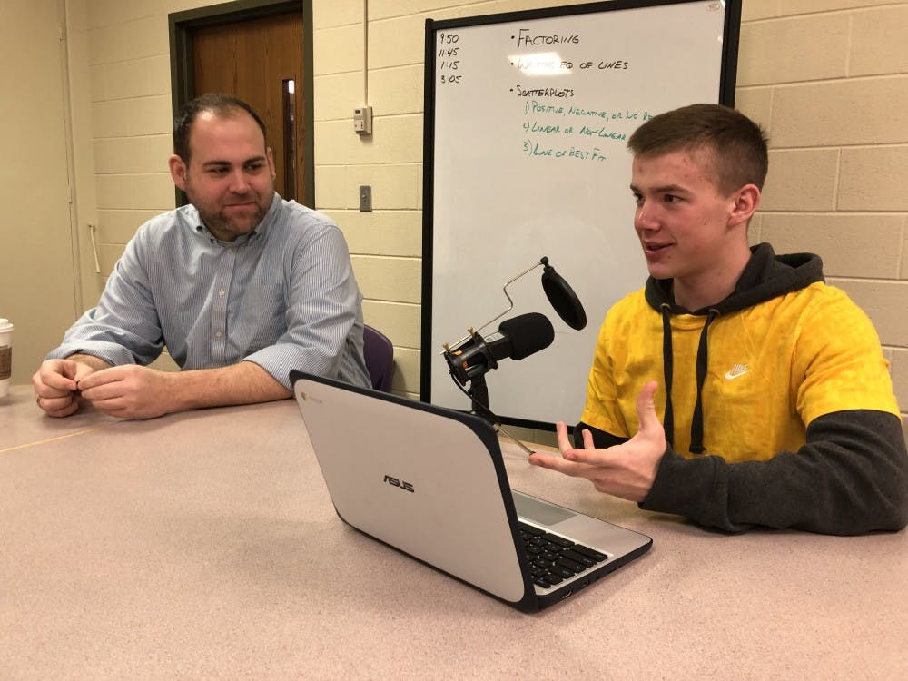<p>Muncie Central High School Social Studies Teacher Drew Shermeta and senior Matt Lloyd show off the technology Shermeta was able to buy for students due to a grant from The Community Foundation of Muncie and Delaware County Inc. <strong>Brooke Kemp, DN</strong></p>