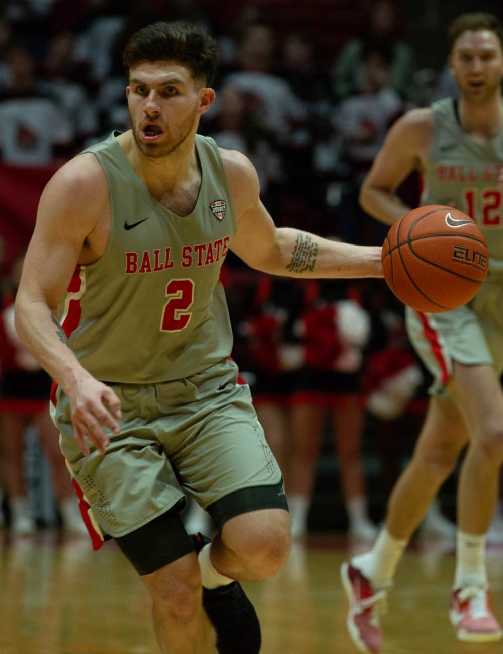 Redshirt senior guard Tayler Persons moves with the ball during the game against the University of Akron Feb. 16, 2019 in John E. Worthen Arena. Ball State defeated Akron 57-56. Scott Fleener, DN