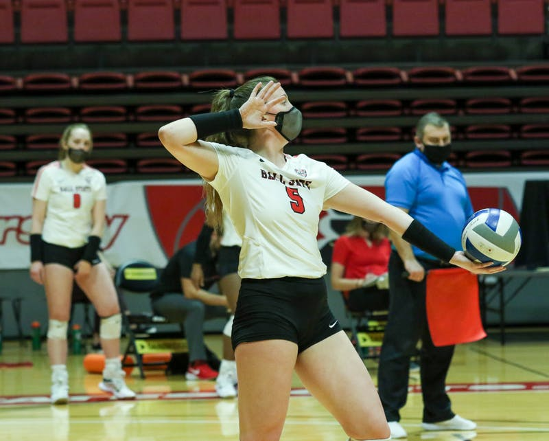 Sophomore middle blocker Marie Plitt serves the ball. The Cardinals later lost to the Chippewas 3-1. Gabi Kramer, DN