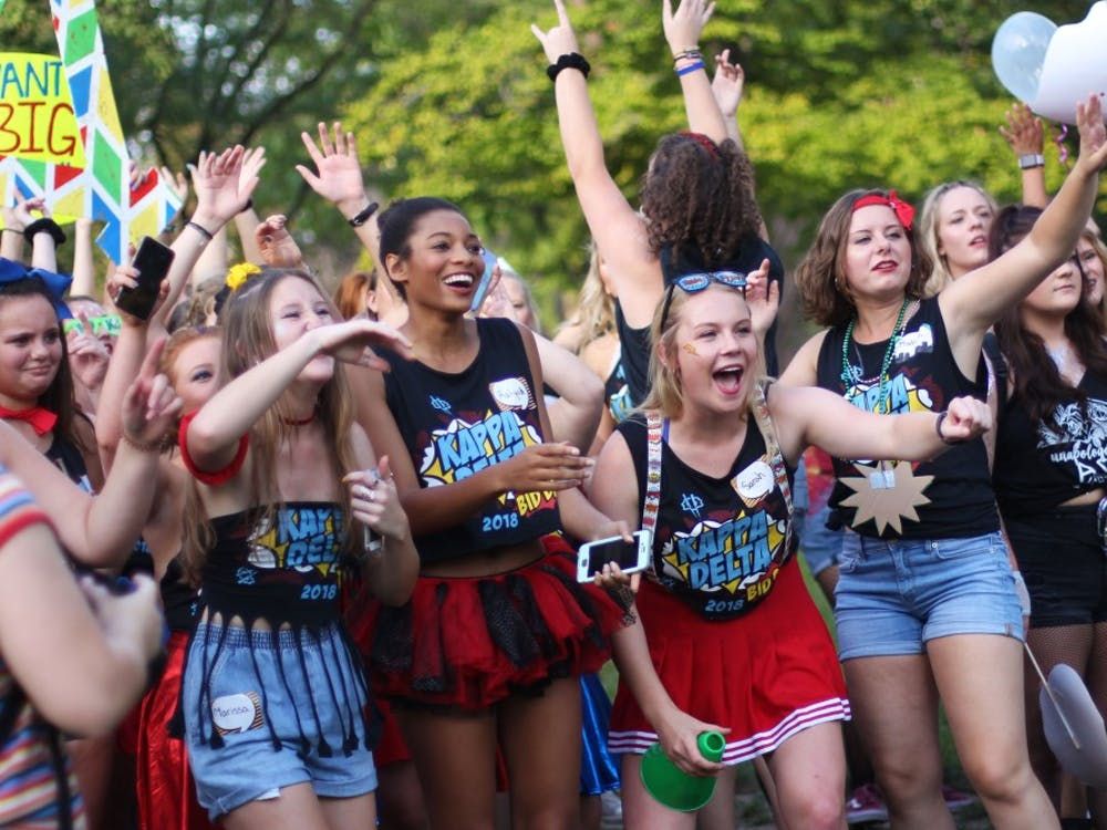 Members of Kappa Delta cheer while waiting on the new members of the sorority to join them on September 16, 2018, at the Quad. Demi Lawrence,DN