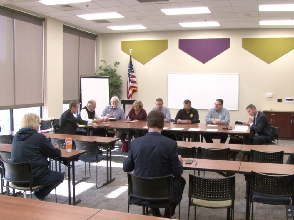 Members of the Delaware County Redevelopment Commission discuss the acquisition of a home located at 7809 Walnut Street in Daleville. The commission met to discuss Daleville's downtown projects, the Morrison sidewalk project and more during a meeting earlier this month. Photo by Konnor Miller.