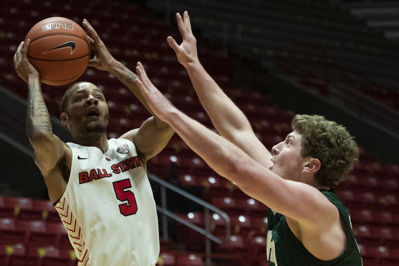 3Ball State Cardinals senior guard Ishmael El-Amin shoots the ball while being guarded during the first half of a game against the Ohio University Bobcats Jan. 2, 2020, at John E. Worthen Arena. The Cardinals lost the Bobcats 78-68. Jacob Musselman, DN