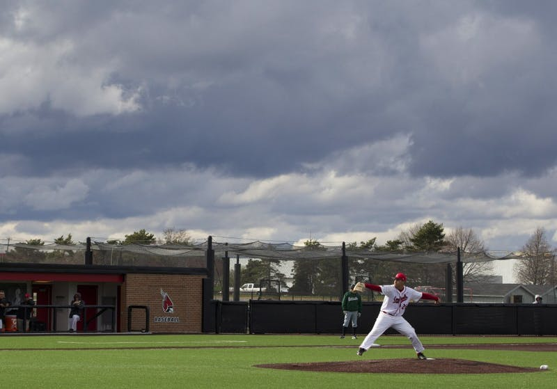 The Ball State baseball team played under stormy skies on April 1 in the game against Ohio. DN PHOTO GRACE RAMEY