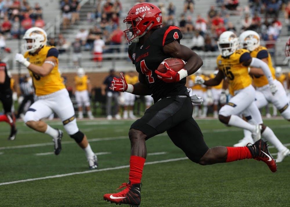 <p>Junior running back Malik Dunner runs the ball up the field at Schuemann Stadium Saturday, Sept. 28, 2018. Dunner had 20 rushing yards during the game against Kent State. Rebecca Slezak,DN</p>