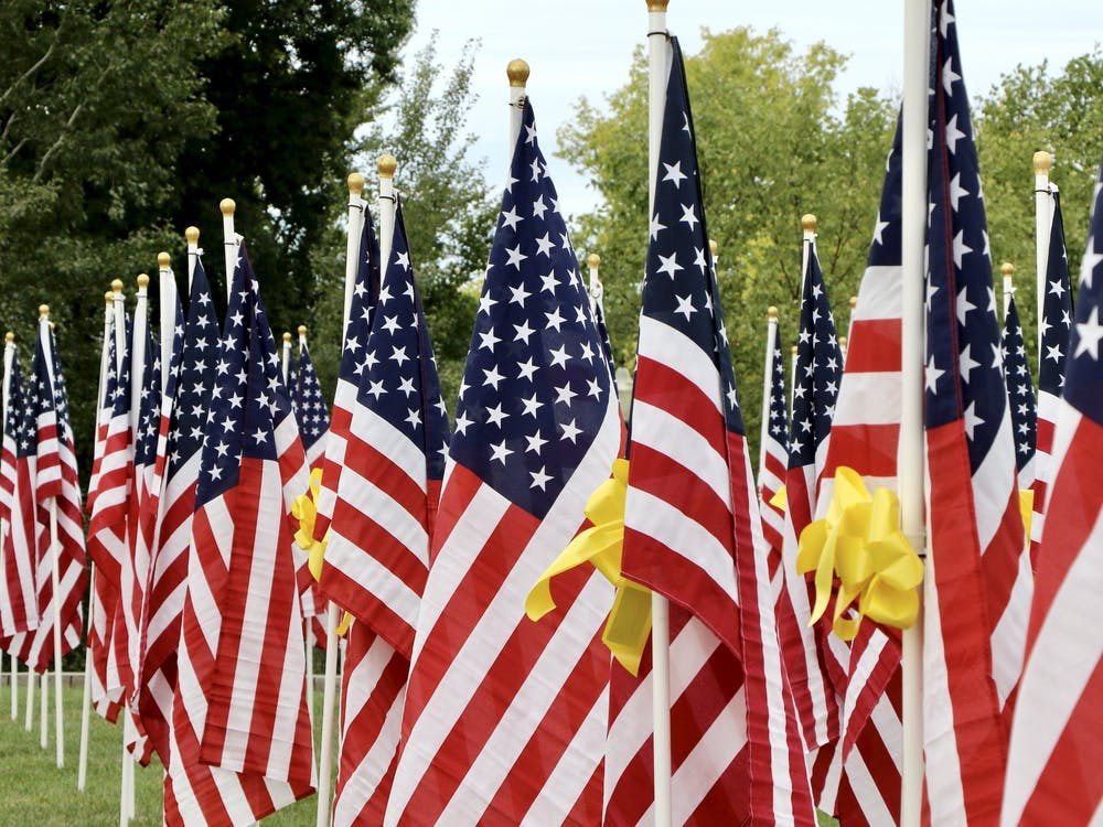 Flags dedicated to fallen military members stand at the Minnetrista Sept. 4.  The 'Flags of Honor' event will be held from Sept. 4 to Sept. 11 for all who wish to honor the fallen heroes of our country. Maya Wilkins, DN