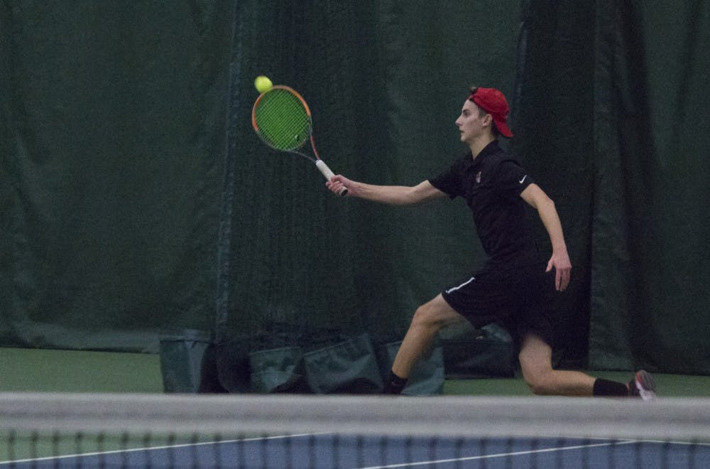 <p>Ball State men's tennis player Chris Adams runs to return the ball during a singles set against Eastern Illinois University on Jan. 20 at the Northwest YMCA of Muncie. <strong>Briana Hale, DN</strong></p>