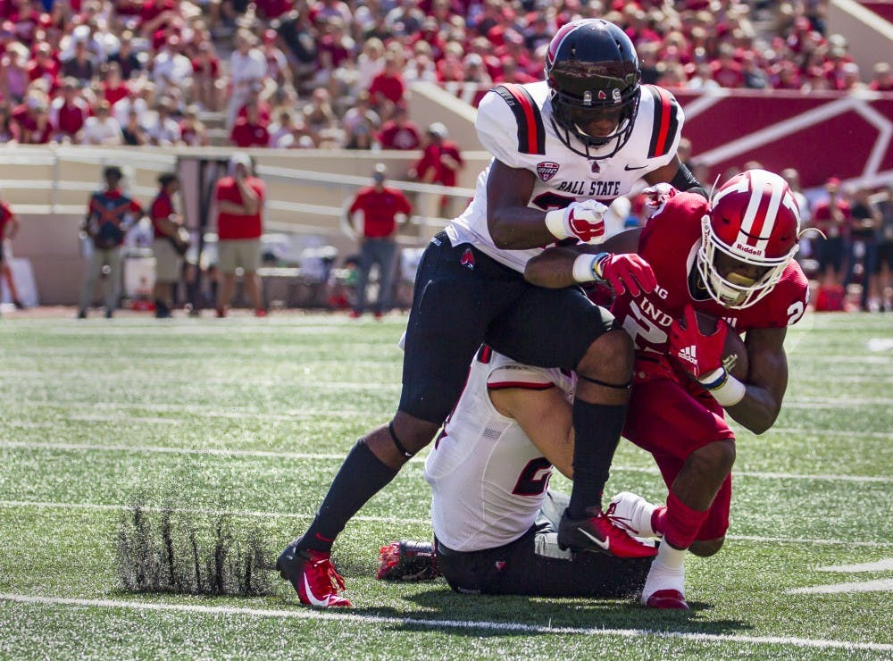 <p>Sophomore wide receiver Whop Philter is tackled by junior safety Brett Anderson II and offensive line backer Jimmy Daw, Saturday, September 15, at Memorial Stadium, in Bloomington, IN. Ball State lost to IU, 10-38, making this their second loss of the season. <strong>Grace Hollars,DN</strong></p>