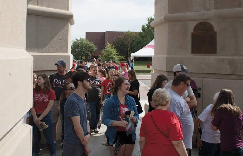 Students and family wait outside Shafer tower to enter during family weekend Sept. 16, 2017 after the Bell Tower recital. This year, another Bell Tower recital is scheduled at 11 a.m. Saturday, Sept. 22, along with other events families can attend on Family Weekend. Rebecca Slezak, DN