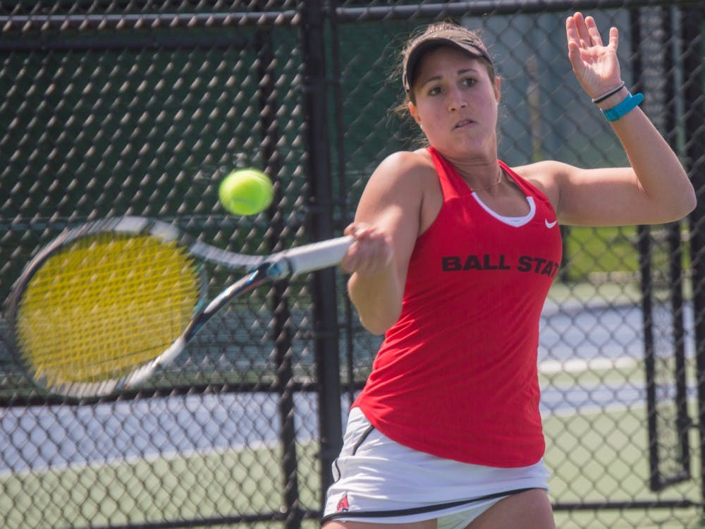 Senior Carmen Blanco hits the ball to the other side of the court during the match against Buffalo on April 2 at the Cardinal Creek Tennis Center. Blanco won her match 2-0. Terence K. Lightning Jr. // DN