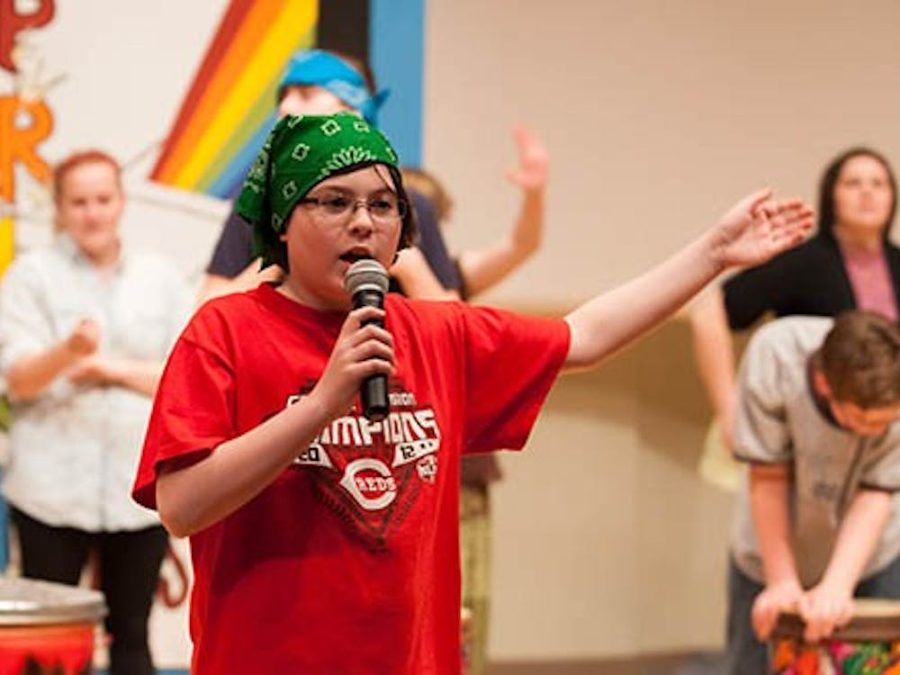 """Carter Tharp performs a part of Eminem's """"Not Afraid"""" during a rehearsal of the Prism Project on Sunday. The event gave children a chance to perform on stage and to advance their social skills. DN PHOTO TAYLOR IRBY"""