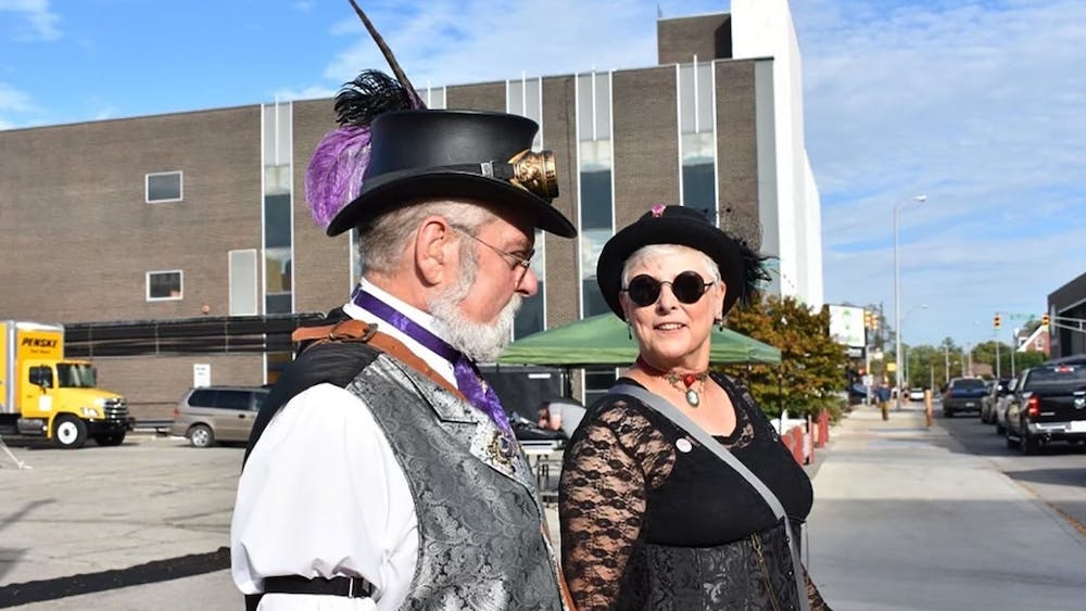 Jesse Creselious (left) and Cindy Britton (right) walk together down the streets of downtown  Muncie March 10, 2019. Their group, The Steampunk Consortium, attends events together such as YART, The Luminary Walk, group picnics and cemetery tours. Jessie Creselious, Photo Provided