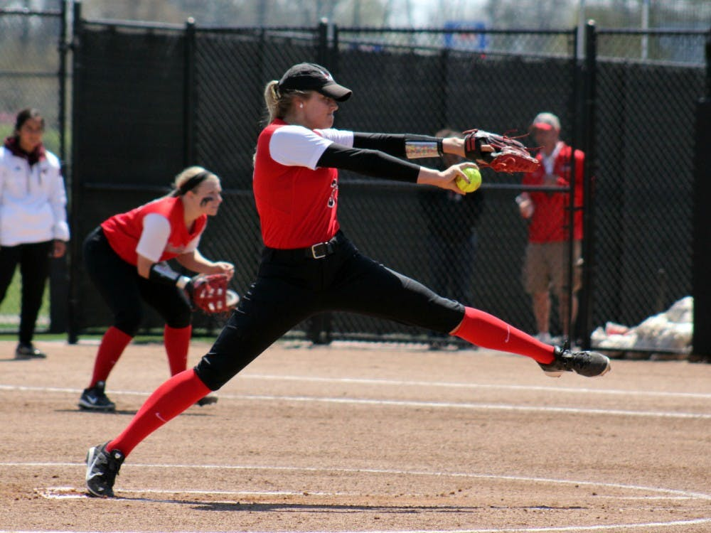 Sophomore Carolyn Wilmes attempts to pitch the ball in the game against Central Michigan at the Varsity Softball Complex on Saturday, April 23, 2016 DN PHOTO ALLYE CLAYTON