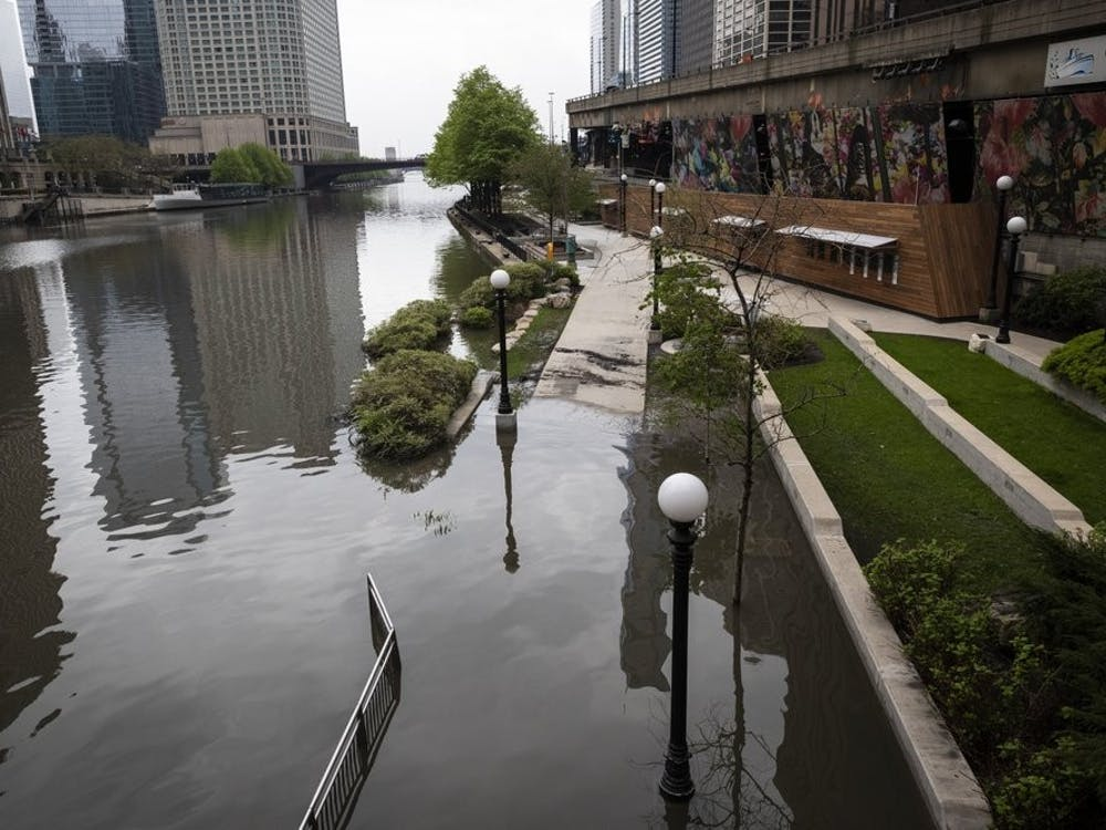 The Chicago River overflowed its banks and flooded the Riverwalk after overnight showers and thunderstorms across the city May 18, 2020 in Chicago. (Ashlee Rezin Garcia/Chicago Sun-Times via AP)