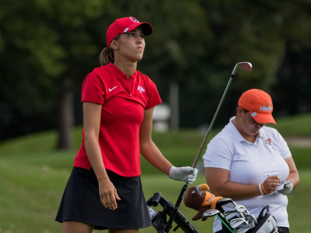 Freshman Hadley Moritz follows her ball to see where it will land Sept. 17, 2018, at the Players Club in Yorktown, Indiana during the Cardinal Classic Golf Tournament. The Cardinal Classics is a two-day golfing event with 36 holes played on the first day and 16 holes on the second. Eric Pritchett,DN