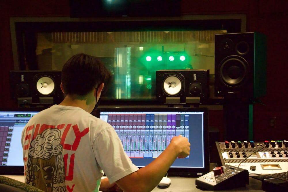 <p>Senior music production major and Cardinal Music Group executive producer Adam Fonacier listens while Pressed in Black records Sept. 12, 2020, in the Music Instruction Building. Fonacier said the band recorded all eight of the songs on their upcoming album. <strong>John Lynch, DN</strong></p>