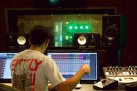 Senior music production major and Cardinal Music Group executive producer Adam Fonacier listens while Pressed in Black records Sept. 12, 2020, in the Music Instruction Building. Fonacier said the band recorded all eight of the songs on their upcoming album. John Lynch, DN