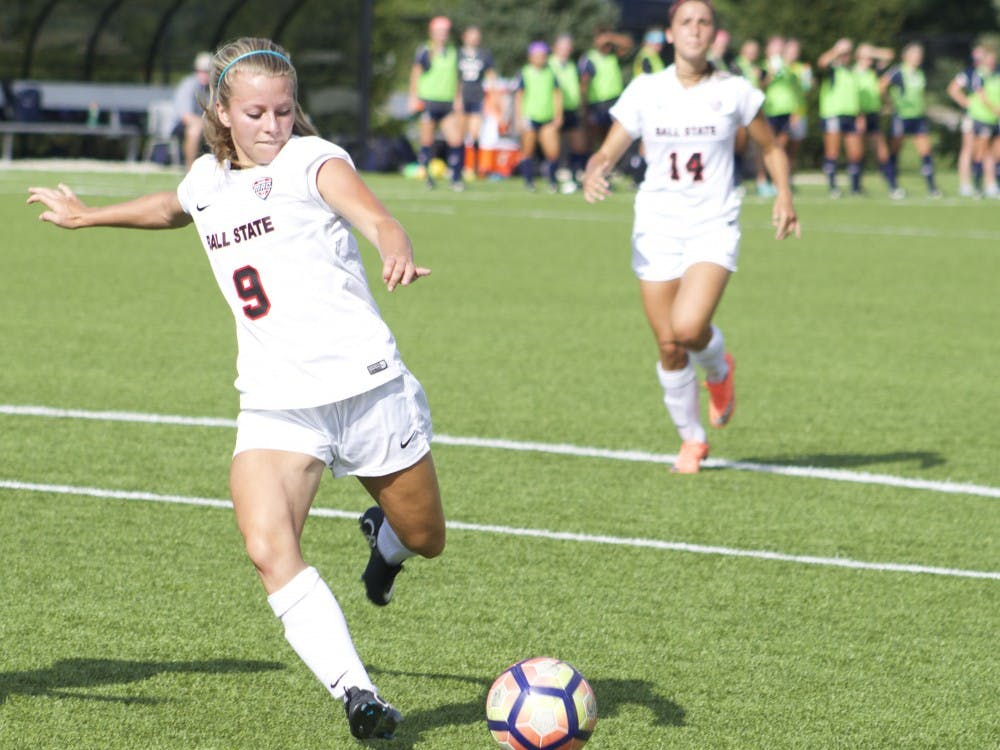 Junior midfielder/forward Allison Abbe goes to kick the ball during women's soccer's match against Xavier University. The team tied 1-1 after a double overtime. Kara Berg // DN