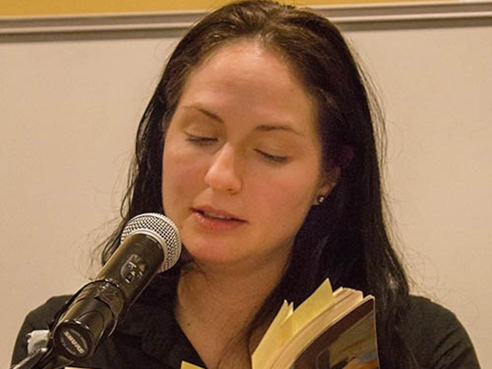 Danielle Cadena Deulen reads a poem from her book entitled Lovely Asunder. Deulen spoke as a part of the English Department's Visiting Writer Series on Feb. 13 in Letterman Building 125. DN PHOTO TAYLOR IRBY