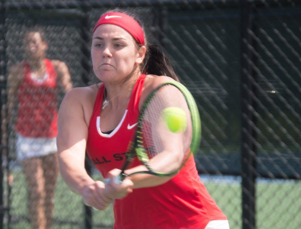 <p>Isabelle Dohanics hits the ball to the other side of the court during the match against Buffalo on April 2 at the Cardinal Creek Tennis Center. <strong>Terence K. Lightning Jr., DN File</strong></p>