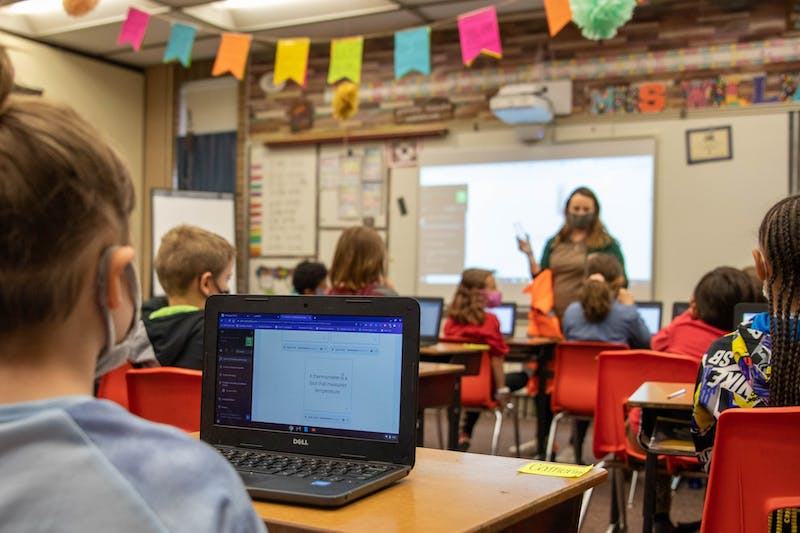 Catherine, a third-grade student at East Washington Academy, uses her laptop to learn about thermometers during her class April 19, 2021. The High Ability Program teaches an advanced curriculum to gifted learners in a separate classroom from the general education population for the whole school day. Jaden Whiteman, DN