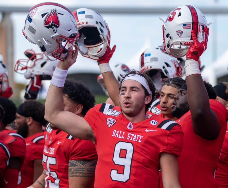 Redshirt Junior Quarterback Drew Plitt sings the Ball State fight song with his team Oct. 19, 2019, at Scheumann Stadium. Plitt had 206 yards against the Toledo Rockets. Jacob Musselman, DN