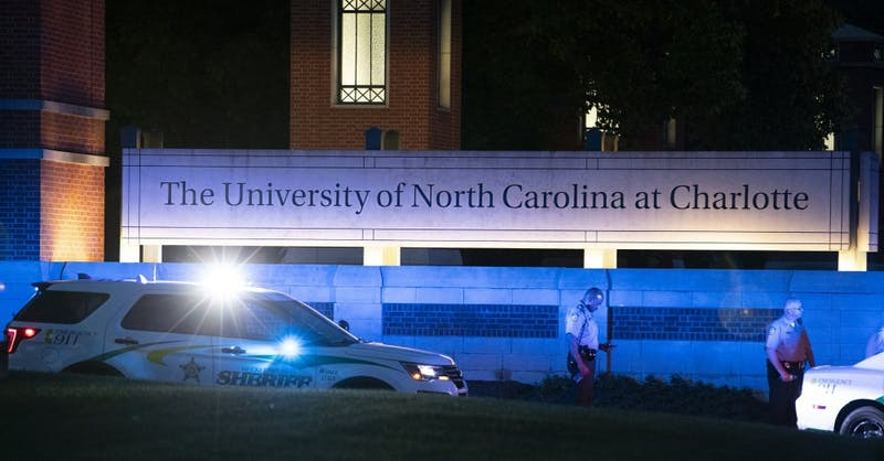 Police secure the main entrance to UNC Charlotte after a shooting at the school that left at least two people dead, Tuesday, April 30, 2019, in Charlotte, N.C. (AP Photo/Jason E. Miczek)